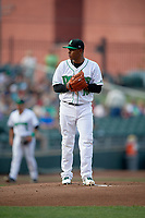 Dayton Dragons starting pitcher Wennington Romero (10) gets ready to deliver a pitch during a game against the Cedar Rapids Kernels on May 10, 2017 at Fifth Third Field in Dayton, Ohio.  Cedar Rapids defeated Dayton 6-5 in ten innings.  (Mike Janes/Four Seam Images)
