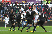 Tammy Abraham of Swansea City heads the ball into the path of Alfie Mawson during the Premier League match between Swansea City and Leicester City at The Liberty Stadium, Swansea, Wales, UK. Saturday 21 October 2017