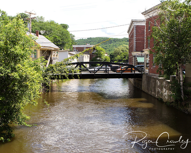 High water flows down the North Branch River in Montpelier, Vermont following several days of hard rain. June 29, 2013.