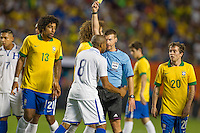 Miami, FL - Saturday, Nov 16, 2013: Brazil vs Honduras during an international friendly at Miami's Sun Life Stadium. Wilson Palacios (8) receives a yellow card.