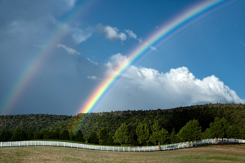 Double rainbow and white fence. Near Prinville, OR