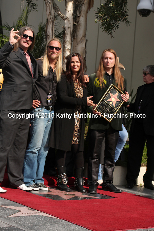 Barbara Orbison (2R) who is the wife of deceased singer Roy Orbison and his sons Wesley (L), Alex (2nd L) and Roy Orbison Jr (R) .Hollywood Walk of Fame Star Ceremony for Roy Orbison .Capitol Records building.Los Angeles, CA.January 29, 2010.©2010 Kathy Hutchins / Hutchins Photo....