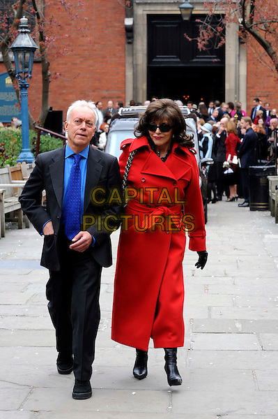 NICKOLAS GRACE & JOAN COLLINS .Dynasty star, Christopher Cazenove's funeral at St. Paul's Church in Covent Garden, London, England..April 16th, 2010.full length blue suit red coat jacket gloves sunglasses shades boots .CAP/IA.©Ian Allis/Capital Pictures.