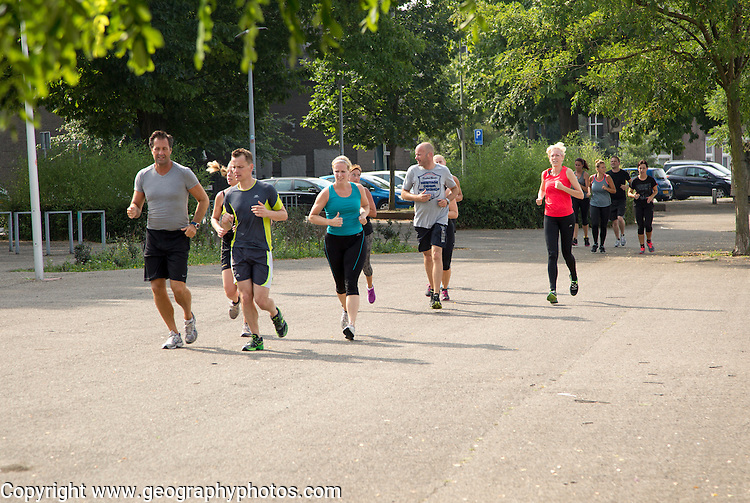 Group of people jogging, Maastricht, Limburg province, Netherlands,