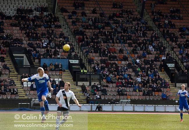 First-half action from the Scottish pyramid play-off second leg between Edinburgh City (in white) and Cove Rangers at the Commonwealth Stadium at Meadowbank in Edinburgh. The match between the champions of the Lowland and Highland Leagues determined which club would play-off against East Stirlingshire for a place in the Scottish league. The second leg ended 1-1, giving Edinburgh City a 4-1 aggregate win.