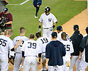 Ichiro Suzuki (Yankees),<br /> JUNE 25, 2013 - MLB :<br /> Ichiro Suzuki of the New York Yankees is greeted by his teammates at home plate after hitting a walk off home run in the ninth inning during the Major League Baseball game against the Texas Rangers at Yankee Stadium in The Bronx, New York, United States. (Photo by AFLO)