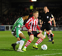 Lincoln City's Danny Rowe shields the ball from Yeovil Town's Rhys Browne<br /> <br /> Photographer Andrew Vaughan/CameraSport<br /> <br /> The EFL Sky Bet League Two - Lincoln City v Yeovil Town - Friday 8th March 2019 - Sincil Bank - Lincoln<br /> <br /> World Copyright © 2019 CameraSport. All rights reserved. 43 Linden Ave. Countesthorpe. Leicester. England. LE8 5PG - Tel: +44 (0) 116 277 4147 - admin@camerasport.com - www.camerasport.com