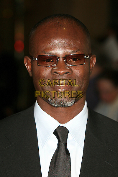 DJIMON HOUNSOU.79th Annual Academy Awards Nominees Luncheon at the Beverly Hilton Hotel, Beverly Hills, California, USA..February 5th, 2007.headshot portrait sunglasses shades goatee facial hair .CAP/ADM/BP.©Byron Purvis/AdMedia/Capital Pictures