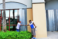 MIRAMAR, FL - OCTOBER 06: Workers put up hurricane shutters in front of a business as Hurricane Matthew approaches the area on October 6, 2016 in Miramar, Florida. The hurricane is expected to make landfall sometime this evening or early in the morning as a possible category 4 storm.Credit: MPI10 / MediaPunch