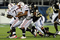 5 December 2009:  FIU linebacker Aaron Davis (45) tackles Florida Atlantic running back Alfred Morris (32) in the first half as the Florida Atlantic University Owls defeated the FIU Golden Panthers, 28-21, in the annual Shula Bowl game at FIU Stadium in Miami, Florida.