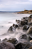 Point Wilson Light and rocky shoreline, Fort Worden State Park, Port Townsend, Washington, USA