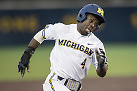 Michigan Wolverines second baseman Ako Thomas (4) rounds third base headed home against the Michigan State Spartans during the NCAA baseball game on April 18, 2017 at Ray Fisher Stadium in Ann Arbor, Michigan. Michigan defeated Michigan State 12-4. (Andrew Woolley/Four Seam Images)