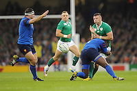 Robbie Henshaw of Ireland is tackled byEddy Ben Arous of France during Match 39 of the Rugby World Cup 2015 between France and Ireland - 11/10/2015 - Millennium Stadium, Cardiff<br /> Mandatory Credit: Rob Munro/Stewart Communications
