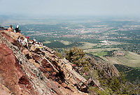 People sit on the summit of Bear Peak overlooking Boulder, Colorado, Saturday, June 4, 2011. Elevation is 8,416 feet. ..Photo by Matt Nager