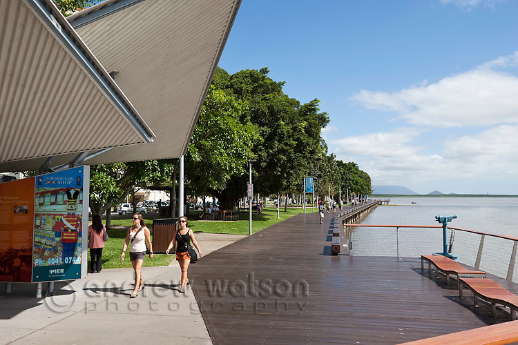 Tourists walking along Esplanade boardwalk.  Cairns, Queensland, Australia