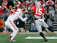 Ohio State Buckeyes running back Ezekiel Elliott (15) holds off Indiana Hoosiers safety Mark Murphy (37)  in the first quarter of their game at Ohio Stadium in Columbus, Ohio on November 22, 2014. (Columbus Dispatch photo by Brooke LaValley)