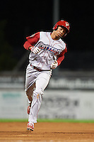 Williamsport Crosscutters third baseman Jan Hernandez (12) runs the bases after hitting a home run during a game against the Batavia Muckdogs on July 15, 2015 at Dwyer Stadium in Batavia, New York.  Williamsport defeated Batavia 6-5.  (Mike Janes/Four Seam Images)