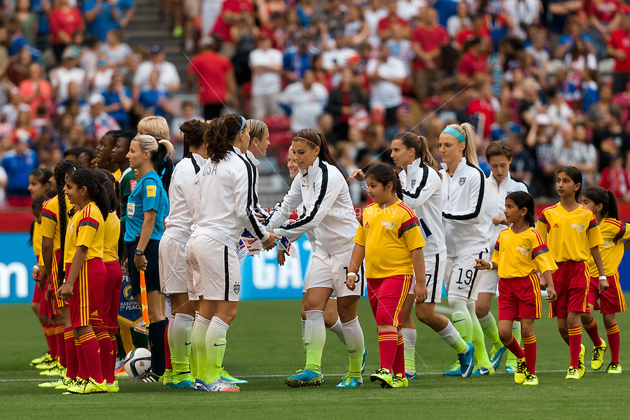 June 16, 2015: The USA team enters the stadium for a Group D match at the FIFA Women's World Cup Canada 2015 between Nigeria and the USA at BC Place Stadium on 16 June 2015 in Vancouver, Canada. Sydney Low/Asteriskimages.com
