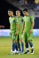 Fredy Montero (17)  Osvaldo  Alonso (6) Servando Carrasco (23) Seattle Sounders line up to take a free kick..... Sporting Kansas City were defeated 1-2 by Seattle Sounders at LIVESTRONG Sporting Park, Kansas City, Kansas.