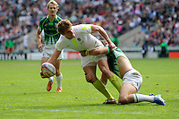 Tom Mitchell of England offloads in the tackle during the iRB Marriott London Sevens at Twickenham on Sunday 13th May 2012 (Photo by Rob Munro)