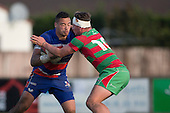 Whairoa Rangiwai battles with Jack Hardie during the Counties Manukau Premier Club Rugby game between Waiuku and Ardmore Marist, played at Waiuku on Saturday June 4th 2016. Ardmore Marist won 46 - 3 after leading 39 - 3 at Halftime. Photo by Richard Spranger.