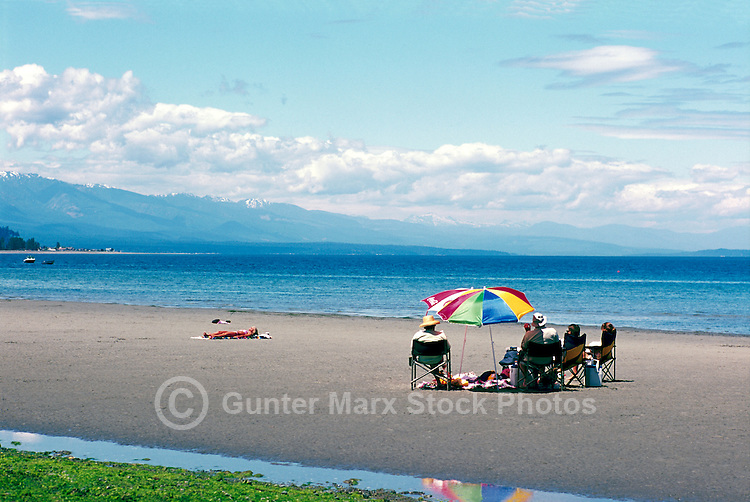 "People sunbathing on the Beach at Qualicum Beach, in the ""Oceanside Region"" of Vancouver Island, British Columbia, Canada"