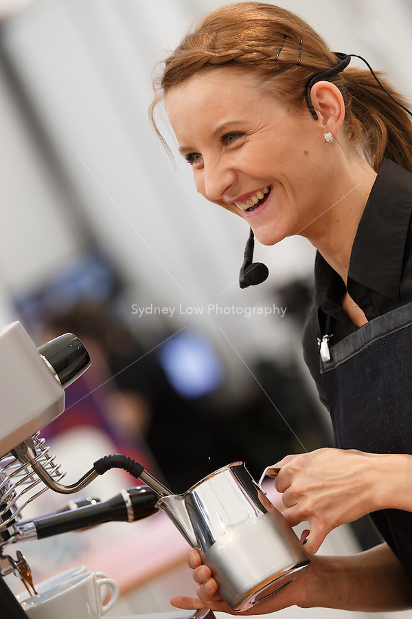 MELBOURNE, 18 MAY 2014 - Edit Juhasz from Hungary competing in the final of the 2014 World Latte Art Championship at the Melbourne Show Grounds in Melbourne, Australia. Christian Ullrich of Germany won the championship from Chiara Bergonzi of Italy and Juhasz. Photo Sydney Low /  asteriskimages.com