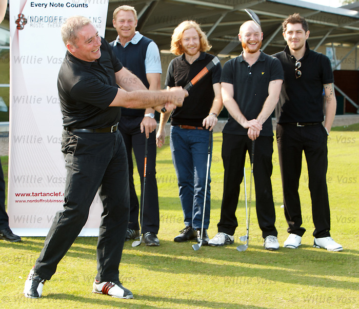 Ally McCoist recovers to blast a shot downrange as he shows Jorg Albertz, Ben and James from Billfy Clyro and Sam McNulty from Twin Atlantic how to belt one out.