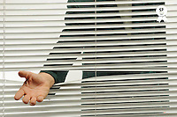 Business man behind blinds need help (Licence this image exclusively with Getty: http://www.gettyimages.com/detail/84754512 )