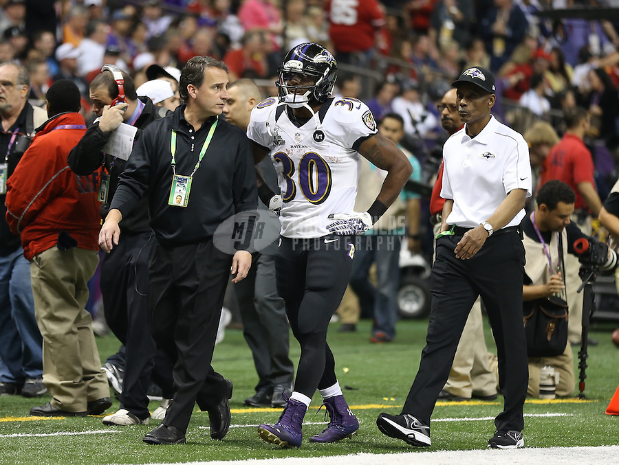 Feb 3, 2013; New Orleans, LA, USA; Baltimore Ravens running back Bernard Pierce (30) is led off the field by trainers after suffering an injury in the first half against the San Francisco 49ers in Super Bowl XLVII at the Mercedes-Benz Superdome. Mandatory Credit: Mark J. Rebilas-