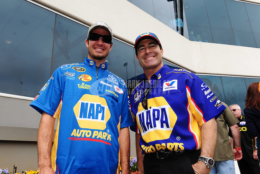 Apr. 15, 2012; Concord, NC, USA: NASCAR driver Martin Truex Jr (left) with NHRA funny car driver Ron Capps prior to the Four Wide Nationals at zMax Dragway. Mandatory Credit: Mark J. Rebilas-