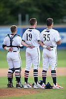 (L-R) Daniel Millwee (7), Mac Sceroler (19) and Glen Batson (35) stand for the National Anthem prior to the game against the Asheboro Copperheads at Finch Field on June 12, 2015 in Thomasville, North Carolina.  The HiToms defeated the Copperheads 12-3. (Brian Westerholt/Four Seam Images)