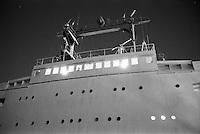 A cargo ship at night