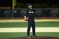 Louisville Cardinals relief pitcher Michael Kirian (33) looks to his catcher for the sign against the Wake Forest Demon Deacons at David F. Couch Ballpark on March 6, 2020 in  Winston-Salem, North Carolina. The Cardinals defeated the Demon Deacons 4-1. (Brian Westerholt/Four Seam Images)