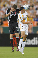 Los Angeles Galaxy forward Hercules Gomez (7) heads the ball in front of DC United defender Bobby Boswell during the game. Los Angeles Galaxy defeated DC United 5-2, Saturday, August 26, 2006 at RFK Stadium.