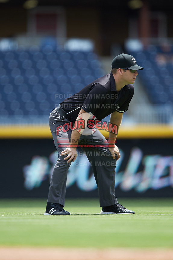 Umpire Brian Peterson handles the calls on the bases during the International League game between the Columbus Clippers and the Durham Bulls at Durham Bulls Athletic Park on June 1, 2019 in Durham, North Carolina. The Bulls defeated the Clippers 11-5 in game one of a doubleheader. (Brian Westerholt/Four Seam Images)