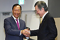 Terry Gou (left), Founder and Chairman of Taiwanese electronics contractor Foxconn (official name Hon Hai Precision Industry Co., Ltd.), and Kozo Takahashi, President and CEO of Sharp Corporation, speak at a joint press conference held at Sakai Display Products Corporation on April 2, 2016 in Sakai Ward, Osaka, Japan. Gou and Takahashi announced the final terms for the deal for the Foxconn to acquire Japans Sharp at discounted rate on after a month of uncertainty. Originally Foxconn had offered $4.4 billion for a two-thirds stake in Sharp, but ended up paying $3.5 billion after undisclosed Sharp liabilities became apparent. Foxconn is expected to use its controlling stake in Sharp to strengthen its negotiating position with its biggest customer, Apple Inc., now that it has access to Japanese companys superior screen display technology. (Photo by Shingo Ito/AFLO)