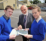 8-6-2012: Leaving cert students from Miltown Presentation Secondary School in County Kerry David O'Shea, Beaufort and Ciara Karalon, Killorglin with school principal Cormac Bonner  reviewing the Geography paper on Friday.<br /> Picture by Don MacMonagle