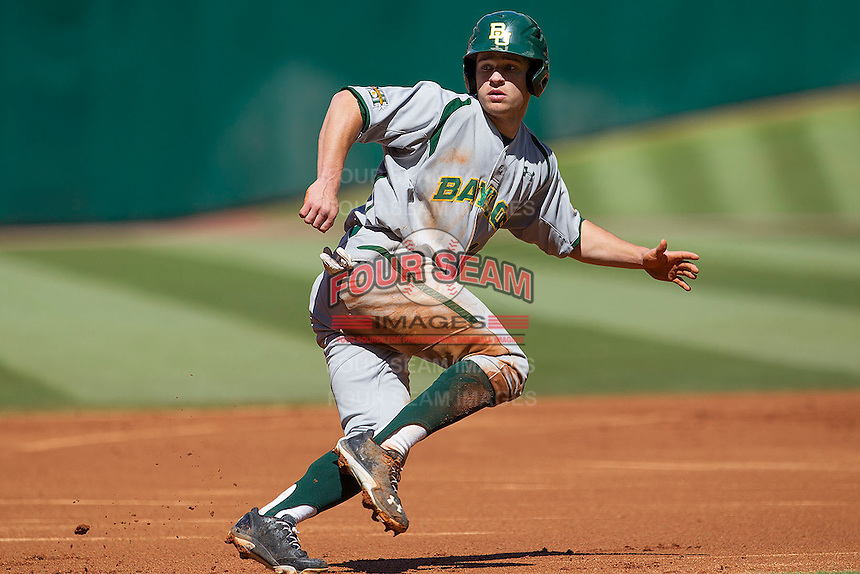 Baylor Bears outfielder Logan Brown #16 is caught in a run down during the NCAA baseball game against the California Golden Bears on March 1st, 2013 at Minute Maid Park in Houston, Texas. Baylor defeated Cal 9-0. (Andrew Woolley/Four Seam Images).