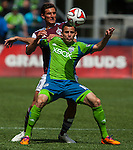 Seattle Sounders' Marco Pappa, front, is guarded by Colorado Rapids' Thomas Piermayr during an MLS match on April 26, 2014 in Seattle, Washington.  The Seattle Sounders beat the Colorado Rapids 4-1.  Jim Bryant Photo. ©2014. All Rights Reserved.