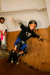 In-line skater Jack Kaplan, 8, of Long Beach, New York, skates the mini ramp while his older brother skateboarder Matt Kaplan, 10, looks on, in Lot 8 at Camp Woodward in Woodward, Pennsylvania.  August 8, 2005.
