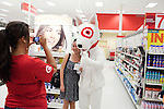 August 20, 2011. Chapel Hill, NC.. UNC students brought to the local Super Target by company chartered buses pose with Bullseye, the Target mascot. Target hired the buses and staged sales to encourage students to buy items in the store that they might need for their dorm rooms.. Many companies have increased their efforts to reach the youth market by employing popular college students to raise the awareness of the brand by peer to peer marketing on campus' around the country.