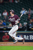 Tanner Poole (12) of the Mississippi State Bulldogs watches the flight of his solo home run in the top of the ninth inning against the Louisiana-Lafayette Ragin' Cajuns in game three of the 2018 Shriners Hospitals for Children College Classic at Minute Maid Park on March 2, 2018 in Houston, Texas.  The Bulldogs defeated the Ragin' Cajuns 3-1.   (Brian Westerholt/Four Seam Images)