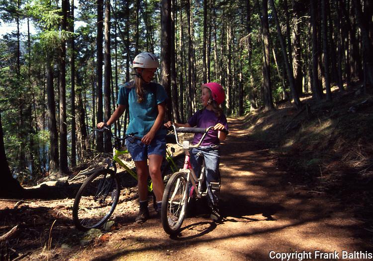 Woman and girl bicycling at Moran State park