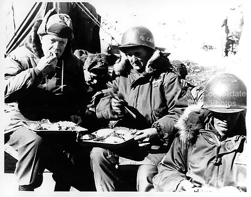 Korea - December 4, 1952 -- United States President-elect Dwight D. Eisenhower eats a meal as he visits with United States troops in Korea  on December 4, 1952..Credit: U.S. Army photo / CNP