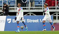 Crystal Palace's Wilfried Zaha (left) celebrates scoring the opening goal <br /> <br /> Photographer Rich Linley/CameraSport<br /> <br /> The Premier League - Burnley v Crystal Palace - Saturday 30th November 2019 - Turf Moor - Burnley<br /> <br /> World Copyright © 2019 CameraSport. All rights reserved. 43 Linden Ave. Countesthorpe. Leicester. England. LE8 5PG - Tel: +44 (0) 116 277 4147 - admin@camerasport.com - www.camerasport.com