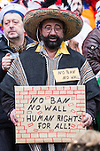 "Düsseldorf, Germany. 27 February 2017. Carnival goer dressed as a Mexican holding a ""No Wall"" sign. Carnival parade on Shrove Monday (Rosenmontag) in Düsseldorf, North Rhine-Westphalia, Germany."