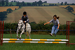 Pony club gymkhana mother and daughter competing together. Daughter on leading rein. Quantock Staghounds 1990s Uk. Quantock Hills Somerset. 1997