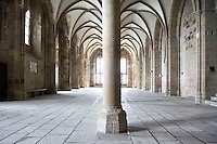 Eastern end of The Guest Chamber, one of the three dining halls lying one above the other at the Merveille (Marvel), 13th century, thanks to a donation by the king of France, Philip Augustus who offered Abbot Jourdain, a grant for the construction of a new Gothic-style architectural set, Le Mont Saint Michel, Manche, Basse Normandie, France. Divided down the centre by a row of columns, lit throughout by high narrow windows. Picture by Manuel Cohen