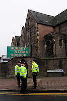 English Defence League (EDL) demonstration<br /> called in protest to the proposed building of a new mosque in Dudley.<br /> Police stand guard outside the Dudley Central Mosque.
